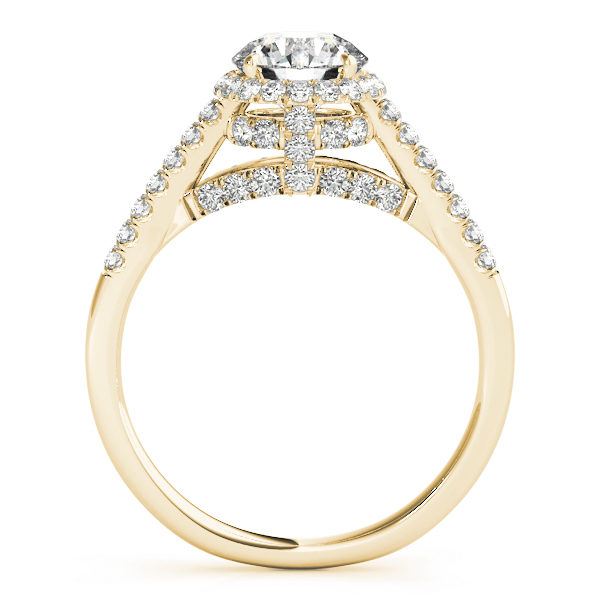 Side view of a halo diamond engagement ring in yellow gold with an open cathedral under gallery embedded with melee diamonds .