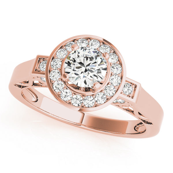 A 4 pronged halo diamond engagement ring in rose gold with a round cut stone with a customised band on a scallop setting embedded with melee diamonds.