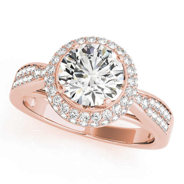 Top view of a 4 pronged halo diamond engagement ring in rose gold with a round diamond cut on a paved setting embedded with melee diamonds.