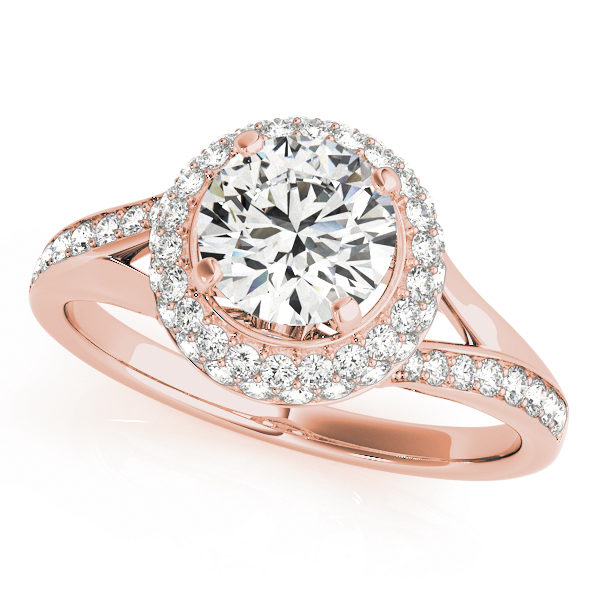 Top view of a 4 pronged halo diamond engagement ring in rose gold with a round diamond cut on a split shank channel setting embedded with melee diamonds.