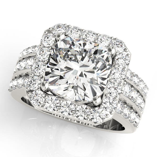 A front view of a white gold radiant style centre cut jewel with a triple diamond band