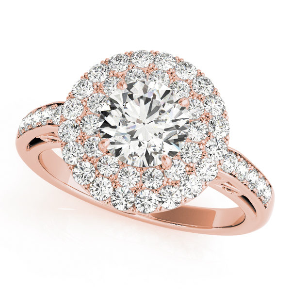 A halo engagement diamond ring in rose gold with a round cut and a channel setting encrusted with melee diamonds.