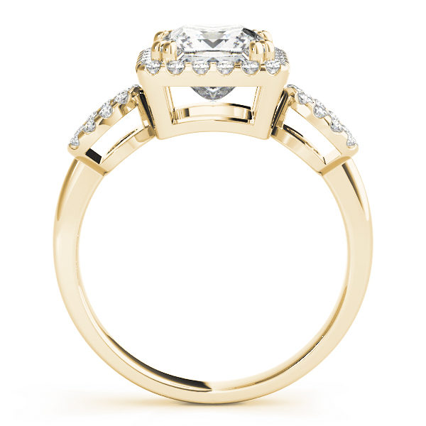 An engagement diamond ring in yellow gold with a princess cut and a cathedral setting encrusted with melee diamonds.