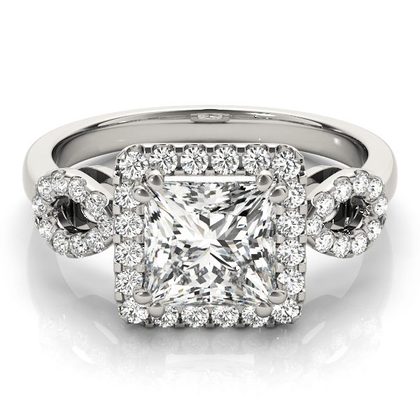 An engagement diamond ring in white gold with a princess cut encrusted with melee diamonds.