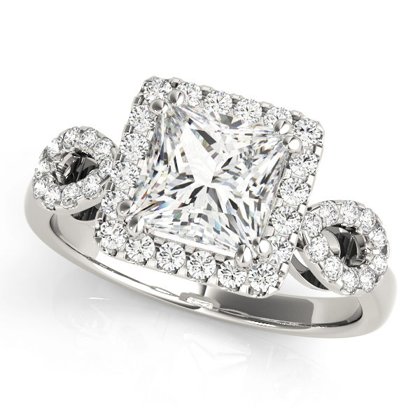 An engagement diamond ring in white gold with a princess cut and a cathedral setting encrusted with melee diamonds.