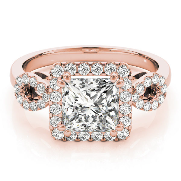 An engagement diamond ring in rose gold with a princess cut encrusted with melee diamonds.