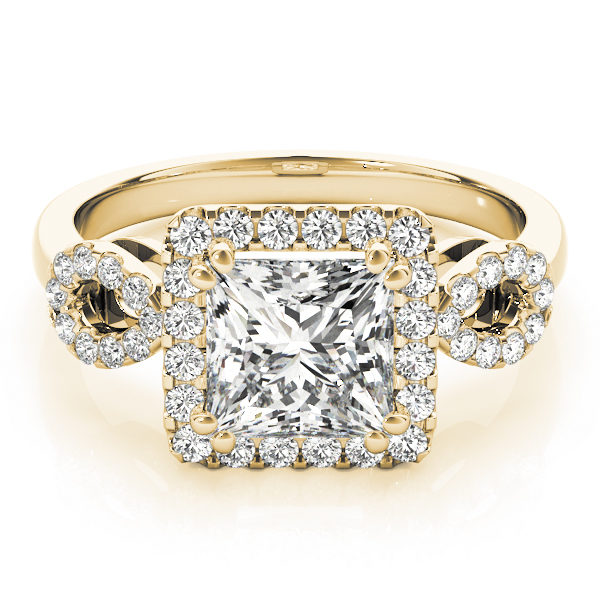 An engagement diamond ring in yellow gold with a princess cut encrusted with melee diamonds.