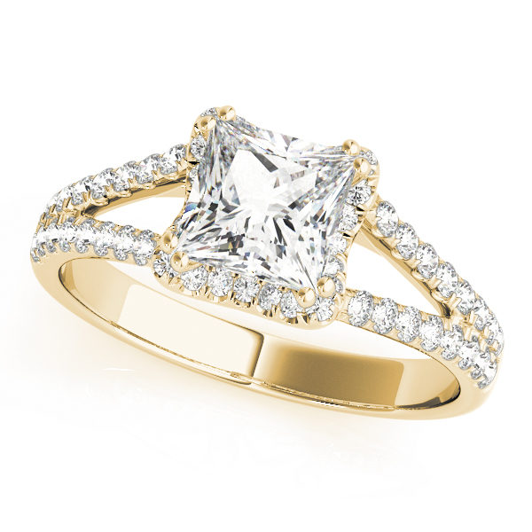 An engagement diamond ring in yellow gold with an asscher cut and a split shank encrusted with melee diamonds.