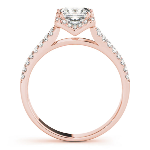 A side view of an engagement diamond ring in rose gold with an asscher cut and a split shank encrusted with melee diamonds.