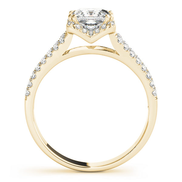 A side view of an engagement diamond ring in yellow gold with an asscher cut and a split shank encrusted with melee diamonds.