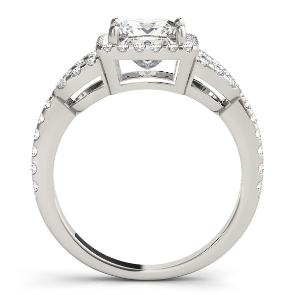 A side view of a white gold 4 pronged princess style centre cut jewel engagement ring with a diamond engraved U-band.