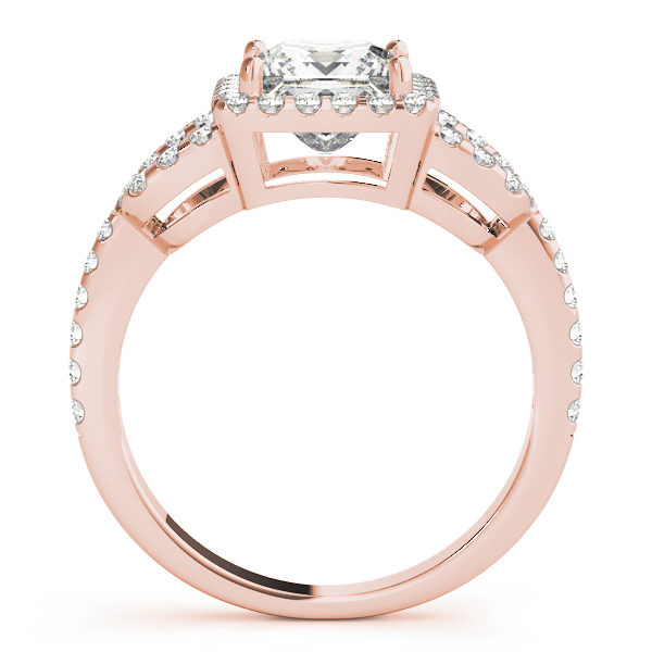 A side view of a rose gold 4 pronged princess style centre cut jewel engagement ring with a diamond engraved U-band.