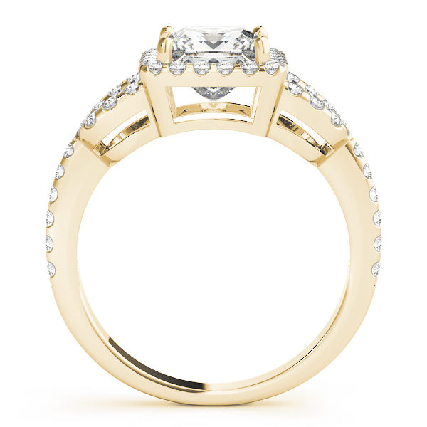 A side view of a yellow gold 4 pronged princess style centre cut jewel engagement ring with a diamond engraved U-band.