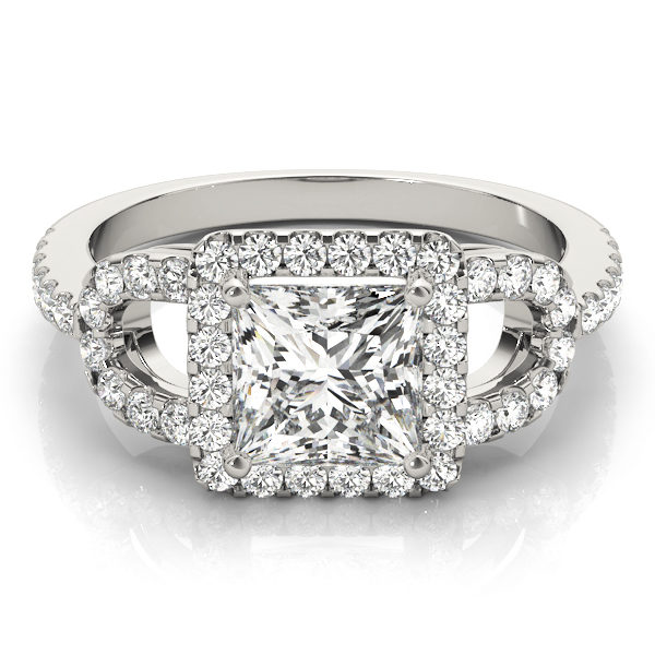 A laying view of a white gold 4 pronged princess style centre cut jewel engagement ring with a diamond engraved U-band.