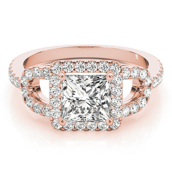 A laying view of a rose gold 4 pronged princess style centre cut jewel engagement ring with a diamond engraved U-band.