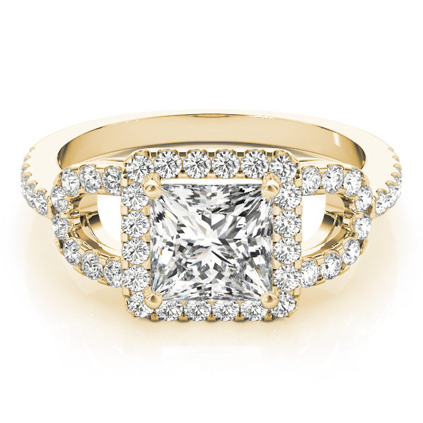 A laying view of a yellow gold 4 pronged princess style centre cut jewel engagement ring with a diamond engraved U-band.