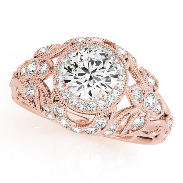 A front view of rose gold flower style engagement ring with round centre cut jewel and shoulder engraved with diamonds and last a complicated tulip vintage band.
