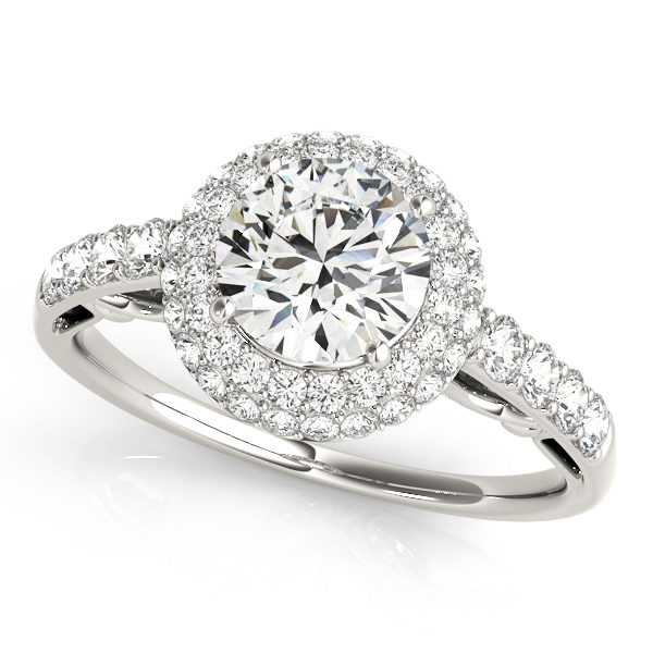 A front view of a white round centre cut jewel engagement ring with a diamond flower style and a diamond engraved band.