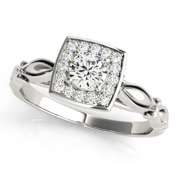 A front view of a white square patterned halo engagement ring with a round centre cut jewel and vintage tulip band