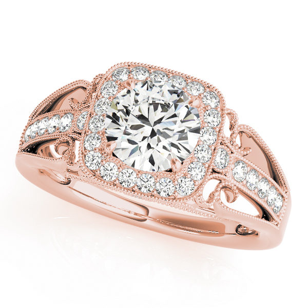 A front view of a rose gold halo engagement ring with a round centre cut jewel and diamond pavement shoulder and a vintage tulip band