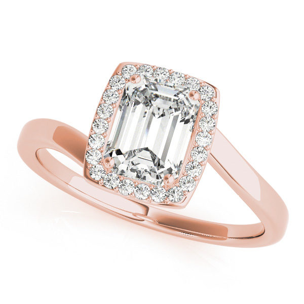 A top view of a diamond engagement ring, with an emerald cut centre jewel surrounded by a halo of diamonds, and a bypass style pale gold band.