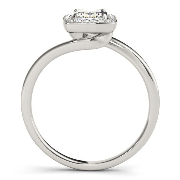 A front view of a diamond engagement ring, with an emerald cut centre jewel surrounded by a halo of diamonds, and a bypass style pale silver band.