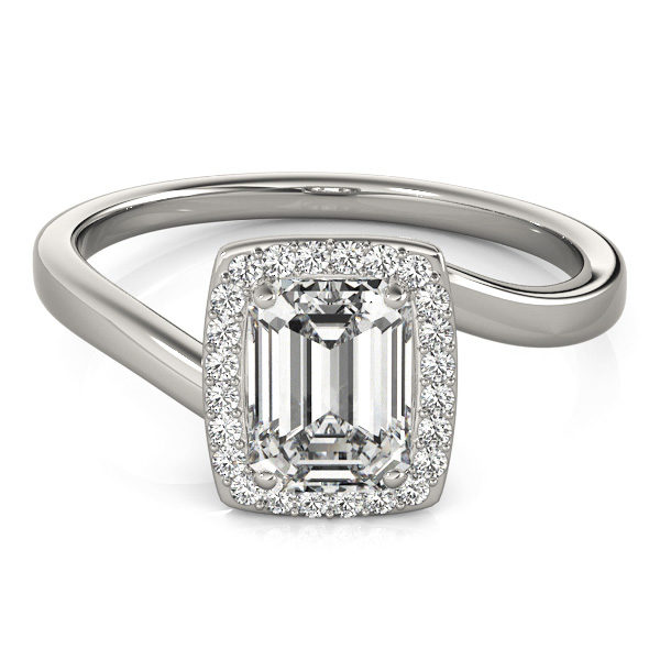 A diamond engagement ring, with an emerald cut centre jewel surrounded by a halo of diamonds, and a bypass style white gold band.