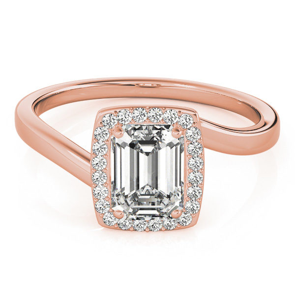 A diamond engagement ring, with an emerald cut centre jewel surrounded by a halo of diamonds, and a bypass style rose gold band.