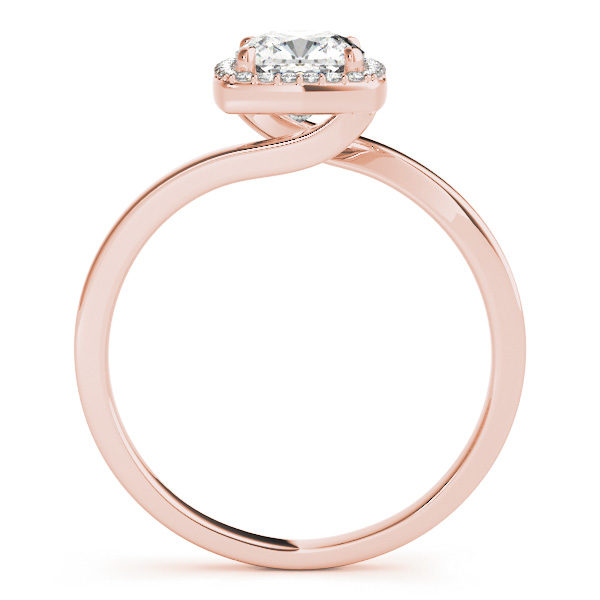 The side view of a rose gold diamond engagement ring with a bypass style band, and a square shaped head in four prong halo set.