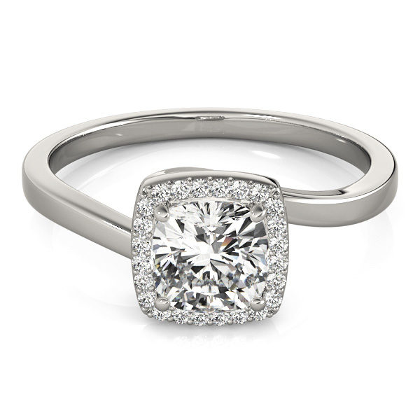 A diamond engagement ring with a four prong halo set square shaped centre piece, and a bypass style white gold band.
