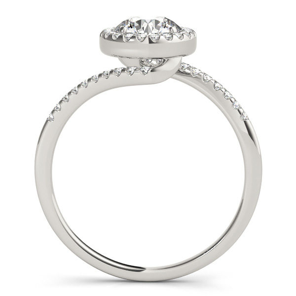 A side view of a white gold diamond halo engagement ring, with a bypass style band decorated with small diamonds set using delicate French V splits.