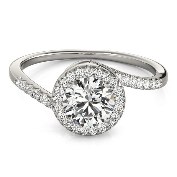 A white gold diamond engagament ring with a halo set head, and a bypass style band with mini diamonds set with a delicate French split.