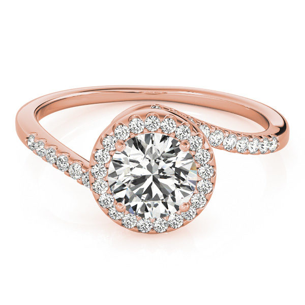 A rose gold diamond engagament ring with a halo set head, and a bypass style band with mini diamonds set with a delicate French split.