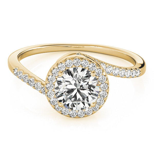 A yellow gold diamond engagament ring with a halo set head, and a bypass style band with mini diamonds set with a delicate French split.