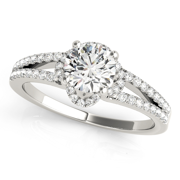 White gold halo split shank engagement ring with set of diamonds embedded on upper shank