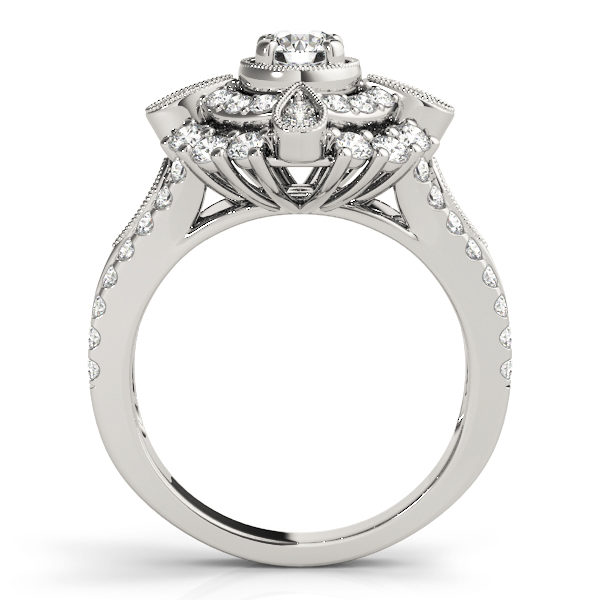 Front view of a white gold vintage halo engagement ring showing the side part of the ring designed with double halo setting and a tear-drop shape filled with two diamonds