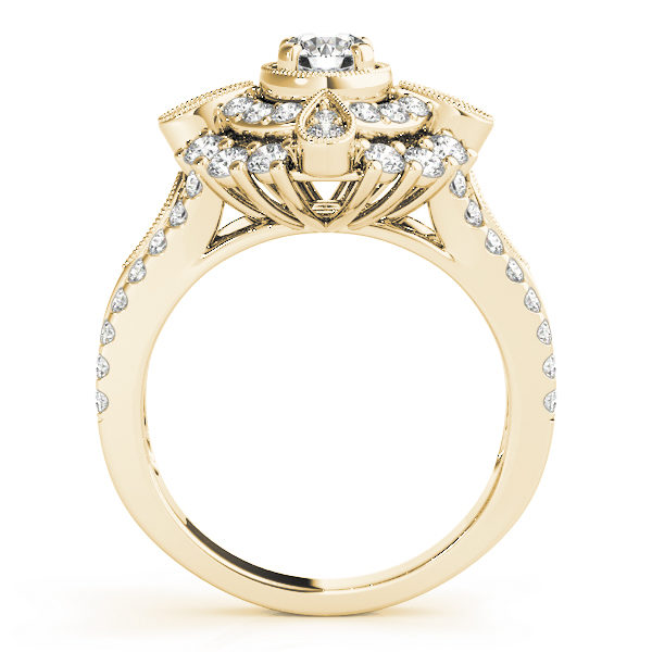 Front view of a yellow gold vintage halo engagement ring showing the side part of the ring designed with double halo setting and a tear-drop shape filled with two diamonds