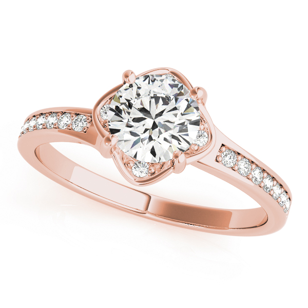Rose gold split band engagement ring with 4 prongs with small diamonds beside the prongs