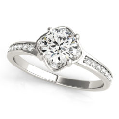 White gold halo engagement ring with 4 prongs with small diamonds beside the prongs