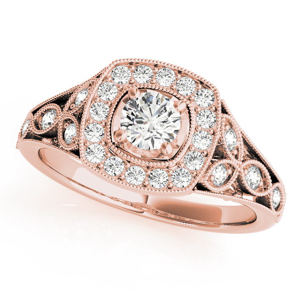 Rose gold vintage halo engagement ring as single diamond is surrounded with smaller diamond formed in square, the band is designed with a leaves with diamond