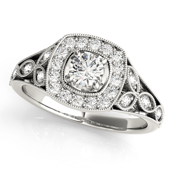 White gold vintage halo engagement ring as single diamond is surrounded with smaller diamond formed in square, the band is designed with a leaves with diamond
