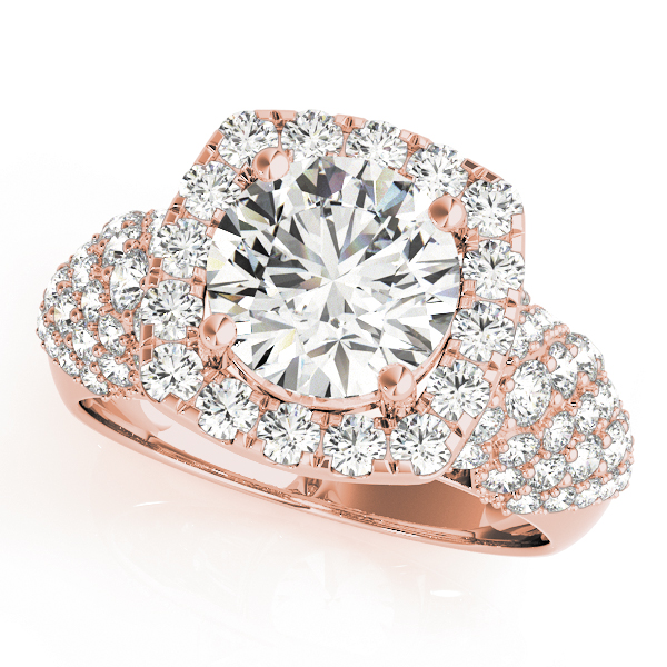 top view of a rose gold diamond halo engagement ring surrounded by clover shaped diamonds also on each shoulder