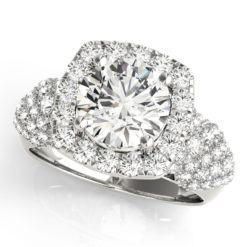 top view of a white gold diamond halo engagement ring surrounded by clover shaped diamonds also on each shoulder
