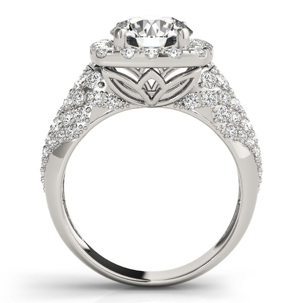 front view of a thick band white gold diamond halo engagement ring surrounded by smaller diamonds also on each shoulder