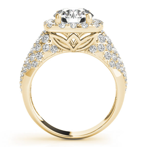 front view of a thick band yellow gold diamond halo engagement ring surrounded by smaller diamonds also on each shoulder
