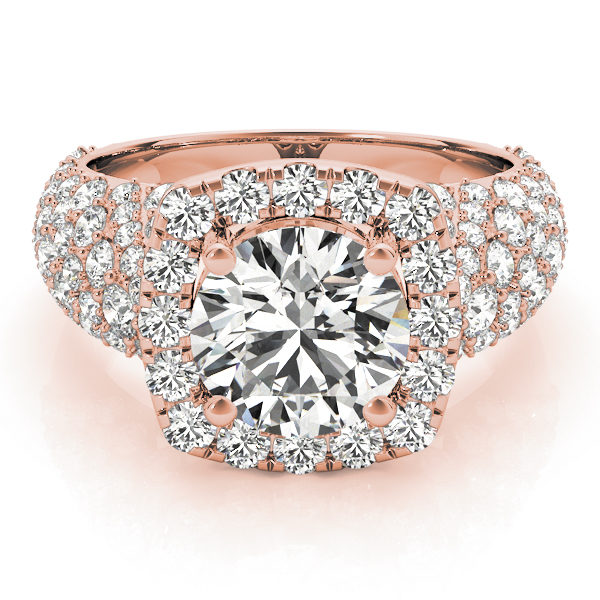 a thick band rose gold diamond halo engagement ring surrounded by smaller diamonds also on each shoulder