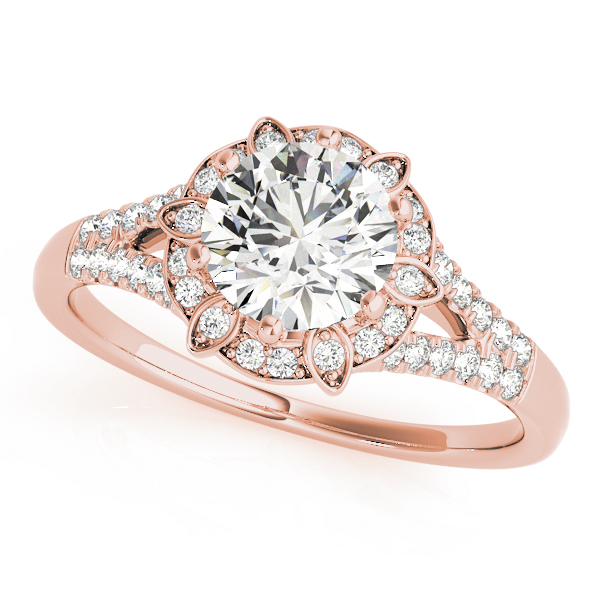 a petite rose gold diamond halo engagement ring surrounded by smaller diamonds on each of the split shanks