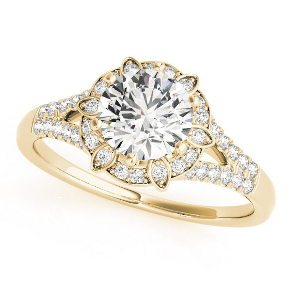 a petite yellow gold diamond halo engagement ring surrounded by smaller diamonds on each of the split shanks