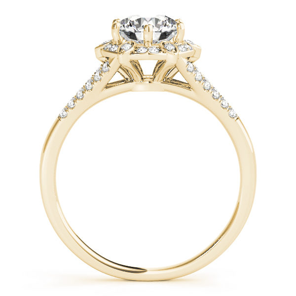 front view of a yellow gold diamond halo engagement ring surrounded by smaller diamonds and on each side of the shoulder