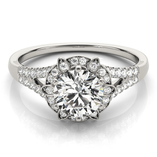 top view of a petite white gold diamond halo engagement ring surrounded by smaller diamonds on each of the split shanks